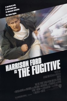 "A black poster. Above in bold white letters are the lines: ""A murdered wife."" ""A one-armed man."" ""An obsessed detective."" ""The chase begins."" In the middle is a picture of an older male with brown hair wearing a white t-shirt, black zippered jacket, black coat, and white pants; running parallel to a train on a subway platform. Below in large white font is the line: ""Harrison Ford"". Below that in smaller white font reads the line: ""is"" with a larger white font next to it reading: ""The Fugitive"". The film credits appear underneath it in a small grey font, along with a line that reads: ""August 6"" in a larger white font."