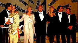 Wild at Heart (film) - David Lynch accepting the Palme d'Or at the 1990 Cannes Film Festival with Isabella Rossellini, Diane Ladd, Anthony Quinn, Laura Dern, Nicolas Cage and Willem Dafoe.