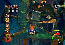Crash Bandicoot drives his kart over a chasm in a futuristic racecourse
