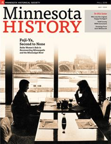 "A sepia-tone photo of two people sitting at a table, silhouetted against a wide river and road bridge in the background, with the words ""Minnesota History"" at top and, in a smaller font below, the text ""Fuji-Ya, Second to None"""