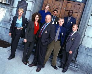 NYPD Blue - Main cast at the beginning of season seven of NYPD Blue, l-r Thompson, Delaney, Brochtrup, Franz, Turturro, Schroder, McDaniel, Clapp