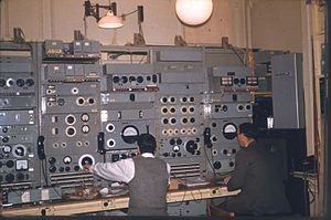 Zobel network - BBC engineers equalising audio landlines circa 1959. The boxes with two large black dials towards the top of the equipment racks are adjustable Zobel equalisers. They are used both for temporary outside broadcast lines and for checking the engineer's calculations prior to building permanent units