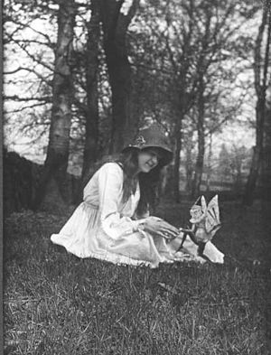 Cottingley Fairies - The second of the five photographs, showing Elsie with a winged gnome
