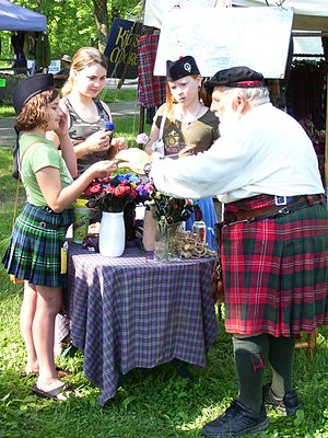 Kentucky Scottish Weekend - A vendor demonstrating roses fashioned from leather at the 2007 Kentucky Scottish Weekend (photo taken 5/12/07)