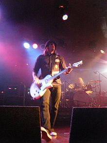 Paul Phillips touring with Puddle of Mudd in November 2011 in the UK.jpg