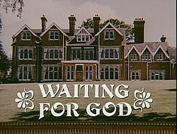 "Front view of large English manor home with large lawn, with text ""Waiting for God"" superimposed"