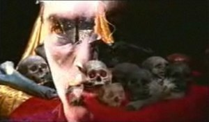 "Zoot Suit Riot (song) - Steve Perry's face superimposed over a bed of skulls, one of many surreal images from the 1998 ""Zoot Suit Riot"" video."