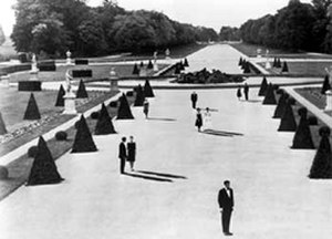 Last Year at Marienbad - Still from L'année dernière à Marienbad; in this surreal image, the people cast long shadows but the trees do not because the shadows were painted and the scene shot on an overcast day.