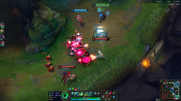 Screenshot of League of Legends, featuring four champions in the bottom lane of the game's primary map, surrounded by minions.
