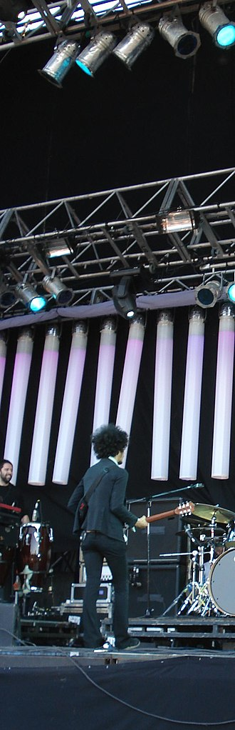 Omar Rodríguez-López - Omar, with back toward the audience, directs the Mars Volta.