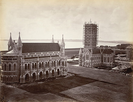 Gothic revival campus of the University of Mumbai, India, showing the Rajabai Clock Tower still under construction in 1878 Rajabai under Const.jpg