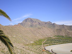 Phreatomagmatic eruption - Crest of old tuff ring, including part of the maar crater of a monogenetic volcano, Tenerife, Canary Islands. The maar crater has been used for agriculture.