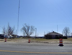 WIMX - WIMX transmitter site and former studio building at 1201 Fremont Pike, Woodville, Ohio. The building at the right of the tower served as its studio location from its beginnings in 1988 to 1993.