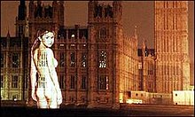Colour photograph of a naked image of Gail Porter projected onto the Palace of Westminster in 1999