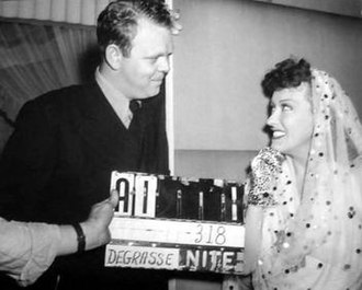 Jack Hively - Hively with actress Gloria Swanson on the set of the 1941 film, Father Takes a Wife
