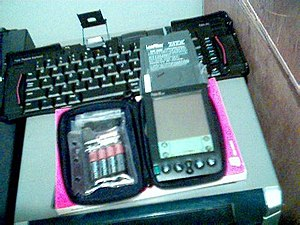Palm (PDA) -  A Palm IIIxe unit with Accessories.