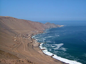 Pisagua, Chile - Pisagua today. At one time several thousand people lived here, and a railway brought nitrate from the interior to be loaded on ships from all over the world. Today a modest open-boat fishing fleet and occasional tourists provide a living for the town.