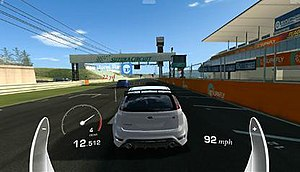 Real Racing 3 - A drag race in Real Racing 3. To maintain top speed, the player must shift gear before the tachometer enters the red.