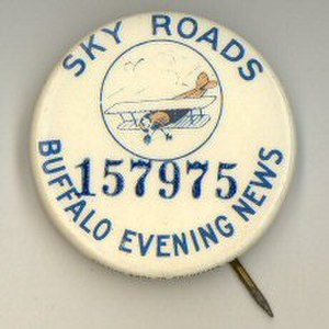 Skyroads (comics) - Pin promoting both comic strip and newspaper.