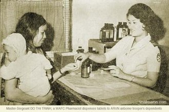 Master-Sergeant and pharmacist Do Thi Trinh, part of the WAFC, supplying medication to ARVN dependents WAFC-ARVN Pharmacist.jpg