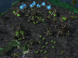 StarCraft II: Wings of Liberty - A Zerg colony gathering resources and expanding its military.