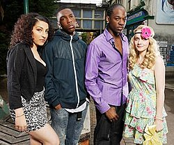 Naz, a woman of Turkish ethnicity, has heavy make-up on her face. She is wearing a short, leopard print skirt, low-cut black top and a black jacket. Standing next to her is Sol, a black man wearing a blue jacket and blue jeans, with his hands in his pockets. Another black man, Asher, is next to Sol, and wears a purple shirt with the top few buttons open. Finally, Stevie is next to Asher. She has blonde hair in curls, and is wearing a light, flowery dress and a headband with a large pink flower on it.