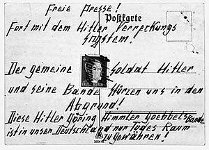 "Otto and Elise Hampel - One of the Hampels' postcards; in the middle is a postage stamp bearing Hitler's face, scrawled with the words ""worker murderer"""