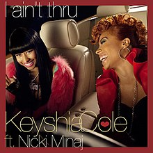 A portrait of two women laughing, sitting in a motor vehicle furnished in beige leather seating. The women are wearing red jackets with black shirts underneath. The portrait is bordered in red, the title 'I aint thru' appears in the top left-hand corner while 'Keyshia Cole ft. Nicki Minaj' appears in the bottom left-hand corner.