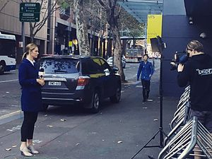Seven News - Seven News Sydney reporter Jessica Dietrich reporting outside the Australian Broadcasting Corporation's Ultimo studios in Sydney, New South Wales.