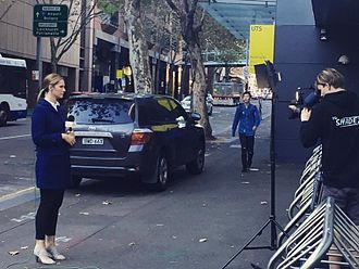 Sunrise (TV program) - A Sunrise reporter reporting outside the Australian Broadcasting Corporation's Ultimo studios in Sydney, New South Wales.