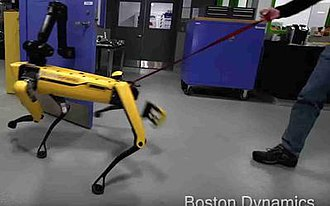 Boston Dynamics - In a 2018 viral promotional video, a rear part of SpotMini's casing falls off as it compensates to overcome interference