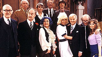 Are You Being Served? - Series 8 cast of 1981. (left to right): (top) Arthur English, Wendy Richard, Benny Lee, Mike Berry; (bottom) Nicholas Smith, Frank Thornton, Mollie Sugden, Vivienne Johnson, John Inman, Kenneth Waller, Louise Burton