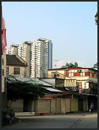 Sha Tau Kok - Chung Ying Street, the famous street of Sha Tau Kok. The high rise buildings are located in Shenzhen.