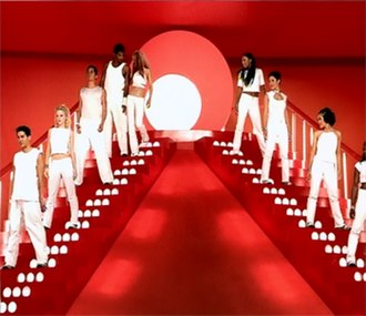 Come On Over Baby (All I Want Is You) - Aguilera walking down the flight of steps while singing to her male dancers