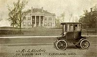 Advertising postcard (pre-1906) for the R&L Electric Car taken in front of the Leonard Hanna mansion on Euclid Avenue