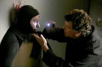 Safe (Fringe) - Walter investigates the episode's case, which involves a man caught inside a wall while robbing a bank.