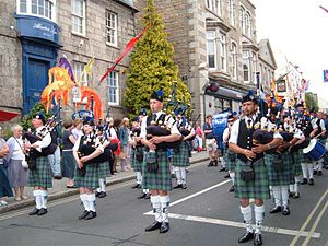 Golowan Festival - A bagpipe band from Mid Argyll walk along Alverton Street