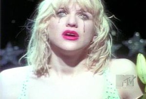 """Miss World (song) - Love's character in the video is almost identical to the character portrayed on the front artwork for Live Through This. Self-image is a major theme of the album and """"Miss World"""" especially."""