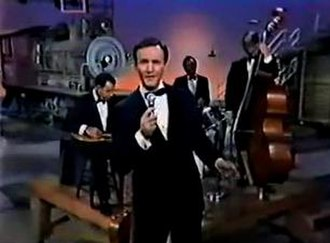 "Roger Miller - Miller performing ""Husbands and Wives"" on the set of his television show in 1966"