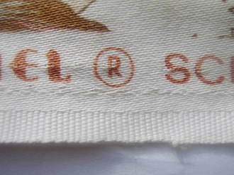 Selvage - A piece of curtain fabric showing its selvedge, i.e. the self-finished edge in the foreground.