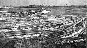 Docklands, Victoria - Lithograph of the area in 1889 looking west from the Hoddle Grid, showing the progress at Victoria Dock and the domination of the area by the rail yards and sheds of the Spencer Street Station complex