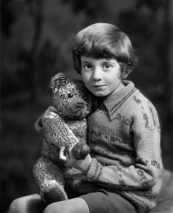 Young Milne with bear