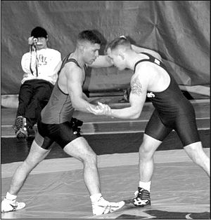 Grappling hold - Two wrestlers clinching.