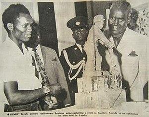 Henry Tayali - Henry Tayali showing some of his artwork to then Zambian President Kenneth Kaunda, 1972