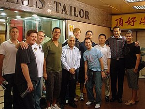 Sam's Tailor - Sam and Roshan with LA Galaxy outside the store in Kowloon