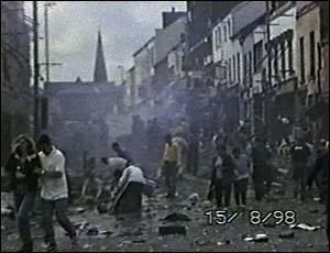 Omagh bombing - The scene in Market Street minutes after the bomb went off. Survivors are shown helping the injured