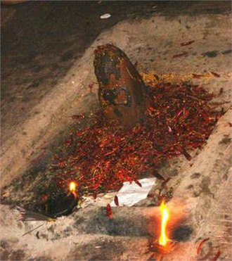 Masani Amman - Main offering, red chilly grinding in Masani Amman