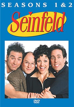 "Four people, three men and a woman, hug tightly and smile in front of a white background. At the top, in front of a blue background, are the words ""SEASONS 1 & 2"" in white, and beneath that phrase is the word ""Seinfeld"", in red."