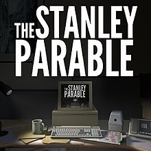 "A dark office desk. The phrase ""The Stanley Parable"" hovers above a square computer monitor. On the desk are a pencil sharpener, a telephone, and other items. A single lamp on the desk shines light onto it. The entire image is repeated within the computer monitor."