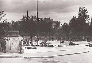"Dekemvriana - Unarmed protesters of EAM lying dead or wounded on 3 December 1944 in front of the Greek Parliament, while others are running for their lives; moments after the first shootings that left at least 28 dead and signalled the beginning of the ""Dekemvriana"" events."